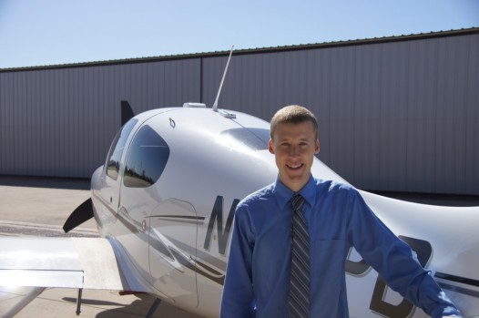 Hank in front of a Cirrus SR22